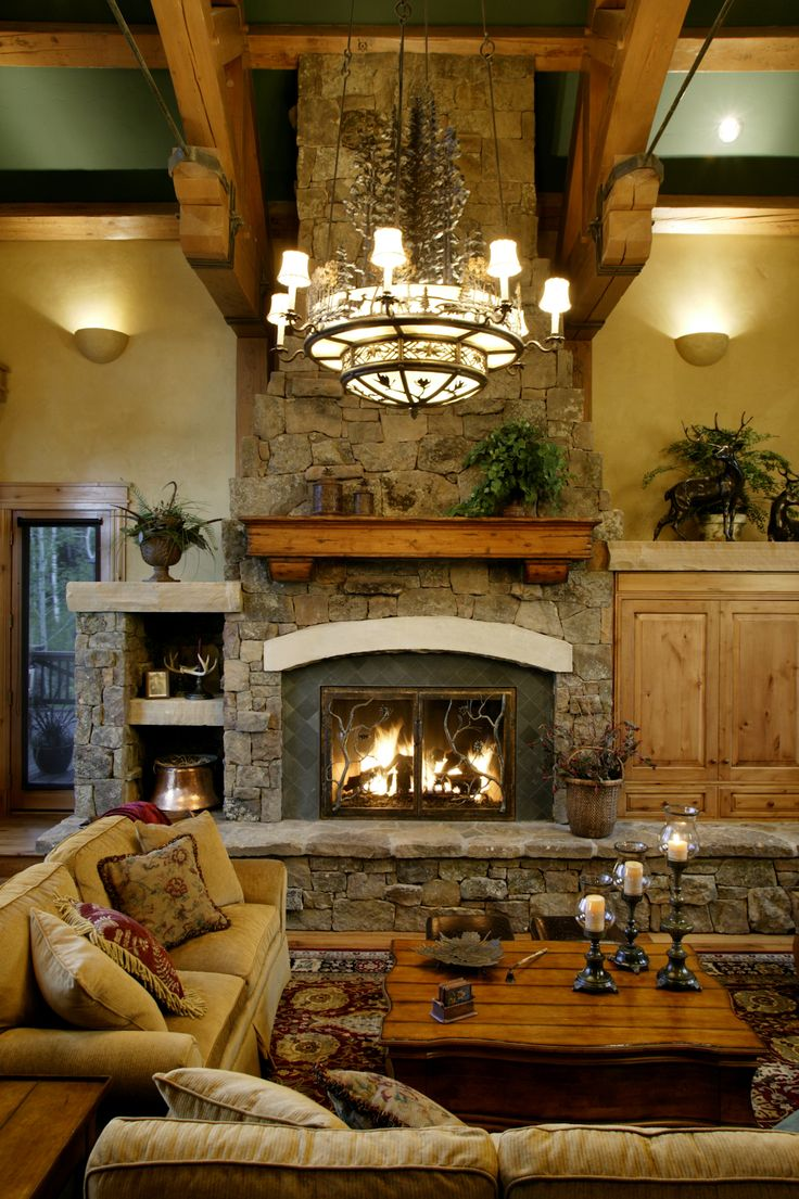 17 best grand fireplace images on pinterest fire places for Rustic stone fireplace