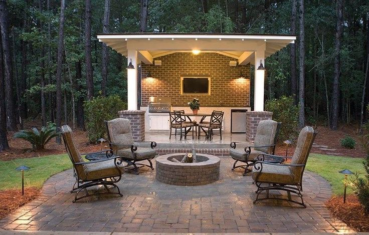 Craftsman Patio with Outdoor kitchen, Nantucket Ledgestone 47 in. Concrete Fire Pit Ring Kit Brown, Carmel Round Dining Table
