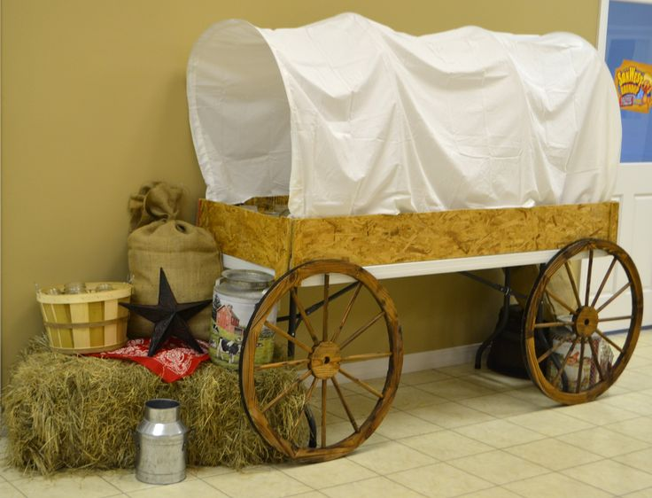 Covered Wagon ~ The base is a folding table with wire used for the frame and a sheet for the cover.