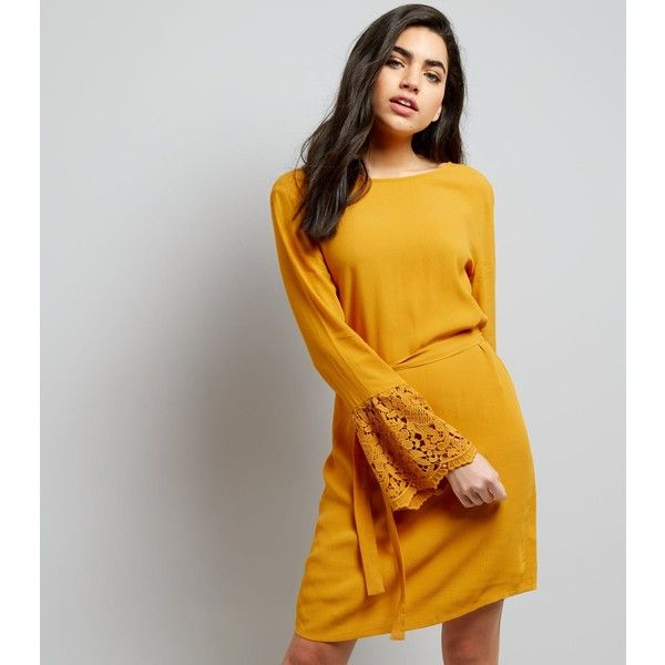 New Look Yellow Lace Bell Sleeve Tunic Dress ($32) ❤ liked on Polyvore featuring dresses, corn yellow, going out dresses, mini dress, lace bell-sleeve dresses, lace sleeve dress and party dresses