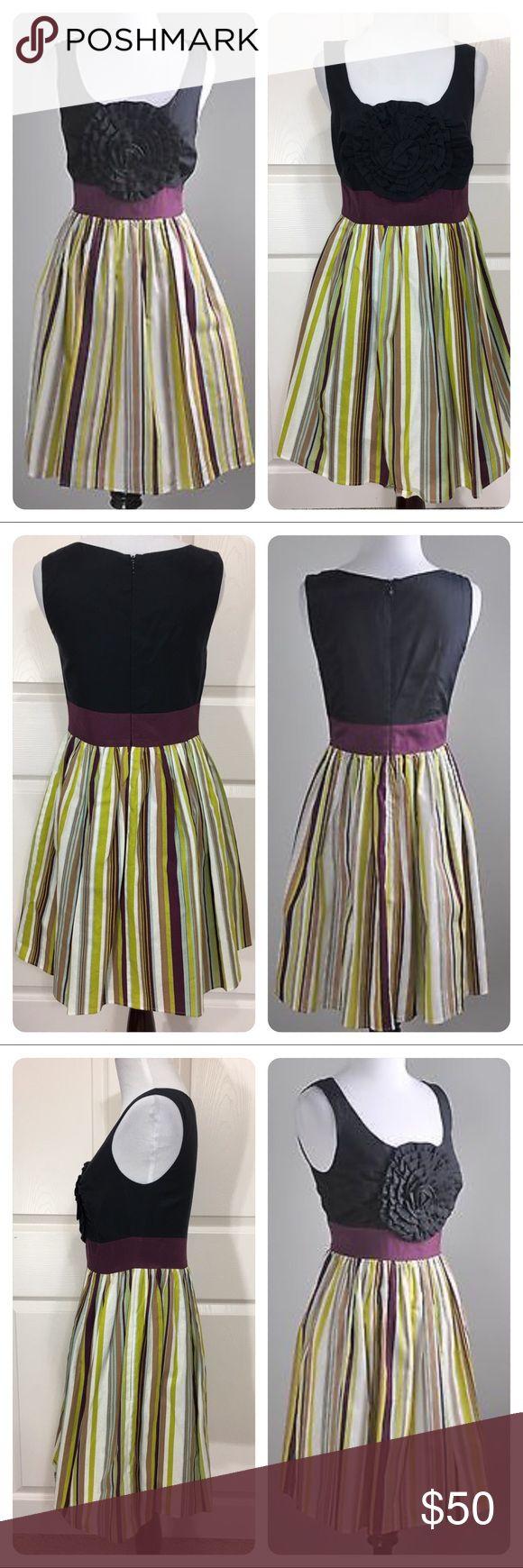 Anthropologie Burlap Rosette Dress Rare Burlap Rosette dress for Anthropologie. Dramatic Rosette on front of bodice. Figure flattering vertical stripes on skirt. Great dress for all occasions! No flaws noted. Anthropologie Dresses