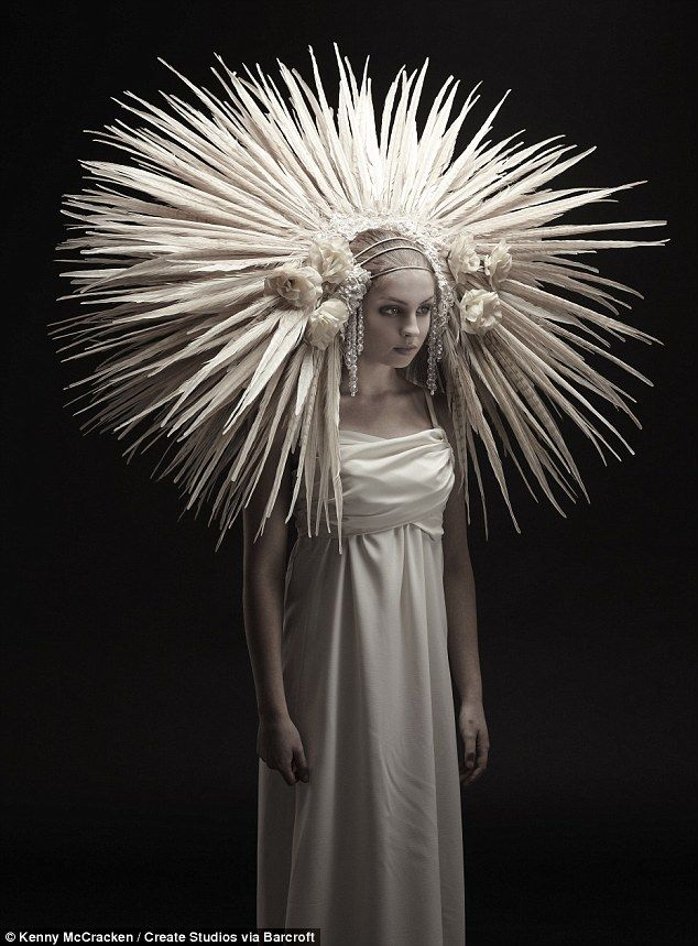 Dramatic: You wouldn't miss this bride coming down the aisle in a head dress made from bird feathers