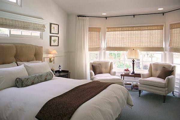 Bedroom windows treatments - woven wood shades in a master bedroom bay window
