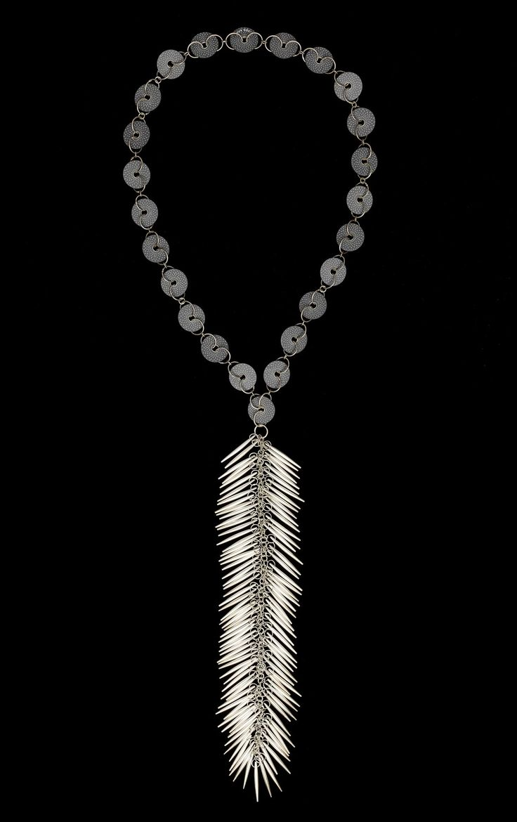 Necklace of decorated slate discs linked by embellished silver rings, with long suspended pendant and elongated lentoid elements of hollow silver: U.S.A., Texas, El Paso, by Rachelle Thiewes, 1994