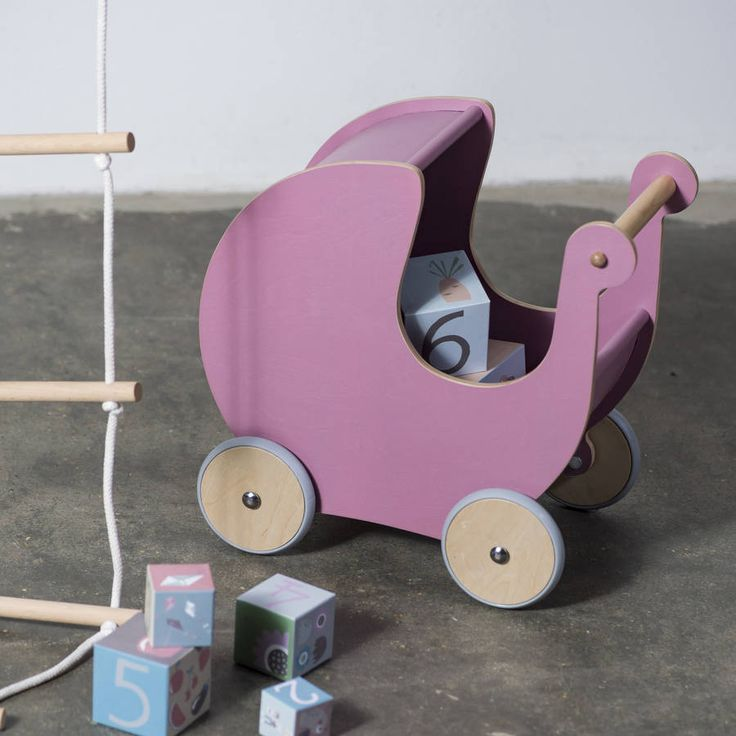 Are you interested in our wooden dolls pram Little Ella james? With our danish design wooden pink dolls pram you need look no further.