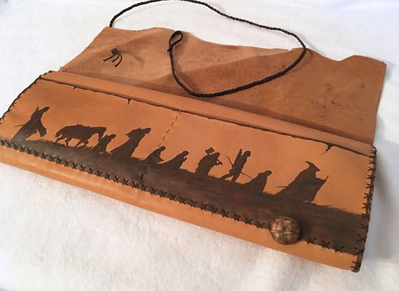 Genuine leather pouch in natural color. The design was burned with pyrographer. Please contact me for costumisation. If you like Lord of the Rings, Vintage maps, Adventure, Fantasy...This pouch will be your precious WHY TO BUY All my items are made with Genuine Greek Leather, with