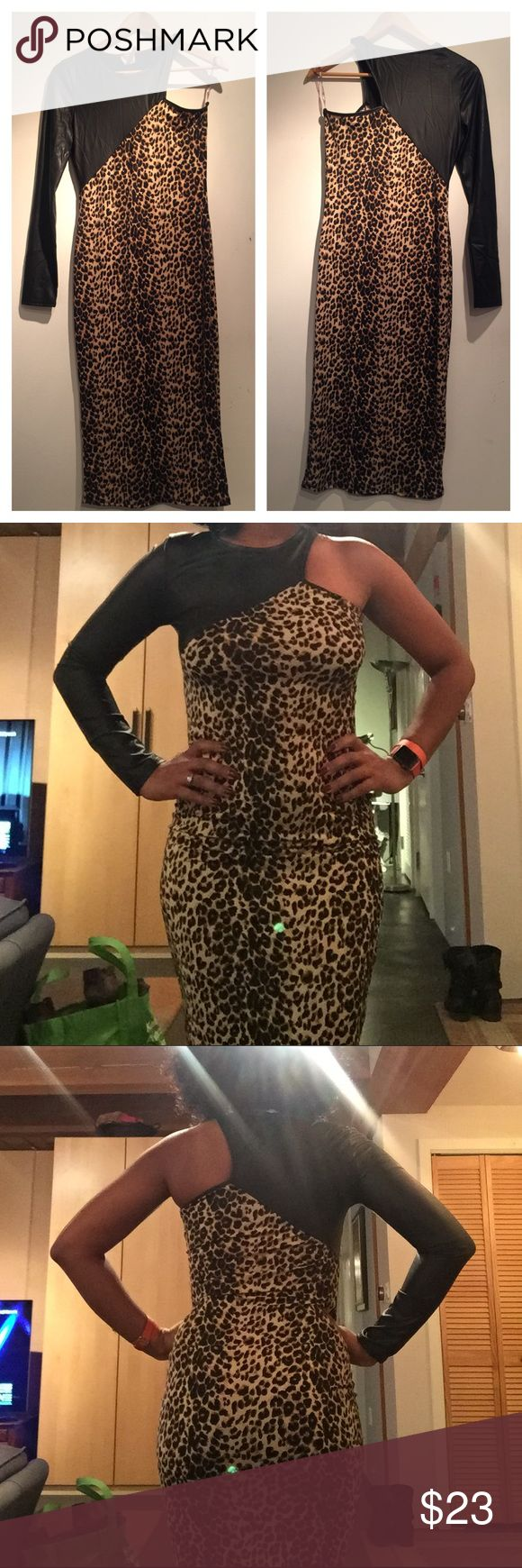 """Sexy One-Shoulder Animal Print Dress This dress drips with """"modest"""" sexiness. I've only worn this dress once for a party that took place during a cold December. You're bound to receive a ton of compliments in this dress. It's  tea-length with 95% polyester and 5% spandex. Excellent condition. Dresses One Shoulder"""