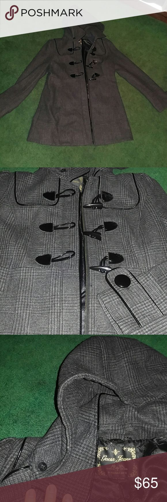"""Wool Dress Coat Beautiful charcoal (dark as shown in first pic) coat with toggle and zipper closure and black faux leather trimming. Detatchable hood, falls around the mid thigh on me and I am 5'9"""". This is a nice winter coat, though it's not super thick. Only problem other than some minor pilling is that some of the seams on the inside of the coat and inside the pockets are coming undone a little, shown in the last picture. Other than that it's a beautiful coat! I love it, just doesn't fit…"""