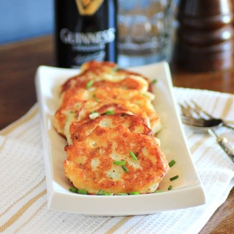Irish Potato Pancakes. These delicious potato pancakes from Noshing with the Nolands highlights this Irish staple.  Buttery mashed potatoes are seasoned with garlic powder and fresh chives and formed into patties.  The potato pancakes are then pan fried until they turn golden brown.   - Foodista.com