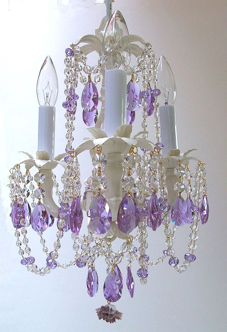 I've been trying to come up with ideas for Hannah's room and have been looking at purple for the wall colors.  The idea of a chandelier came to me for her light and then I saw this one!