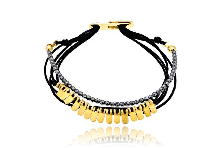 Βραχιόλι με ημιπολύτιμες πέτρες (αιματίτη) και μοτίφ από επιχρυσωμένο ασήμι 925. Bracelet with semi precious stones (hematite) and motifs made by yellow gold-plated silver 925. Price:  105 €