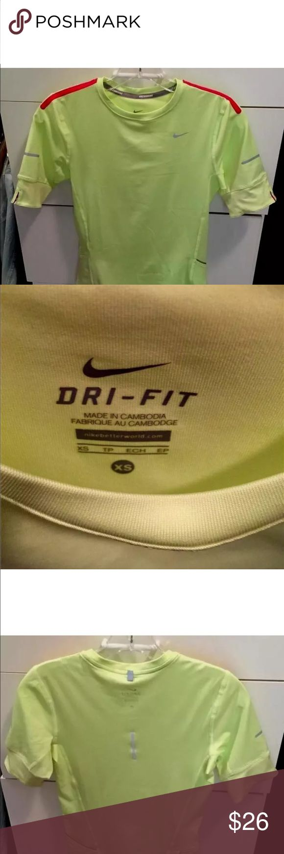 NIKE DRI-FIT ACID YELLOW SHORT SLEEVE TOP SIZE XS NIKE DRI-FIT ACID YELLOW SHORT SLEEVE TOP SIZE XS  GREAT SLEEVE DETAIL WITH THE RED Nike Tops Tees - Short Sleeve