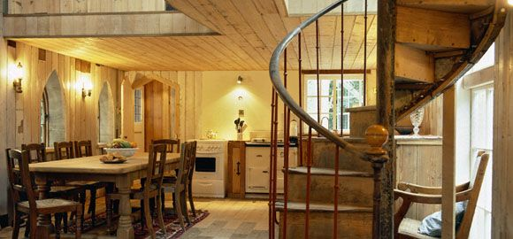 Beautiful hand crafted wooden spiral staircase leads to the bedrooms above.