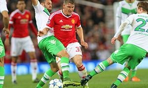 Manchester United's Bastian Schweinsteiger is in the thick of the action against Wolfsburg.