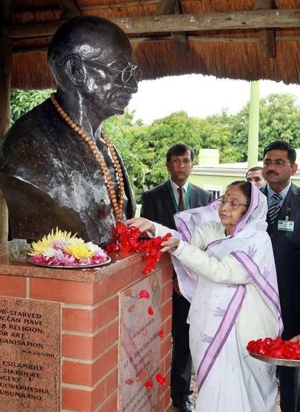 Indian President Pratibha Patil lays flowers at the bust of Mohandas Gandhi at the Mahatma Gandhi Settlement in Phoenix north of Durban on 07 May 2012, the site where Gandhi began the non violent struggle against apartheid 112 years ago.