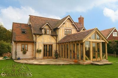 Gorgeous oak frame house with stunning glass sunroom by Oak Masters.