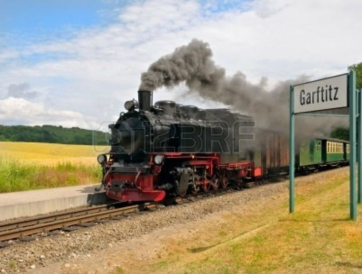 Steam train approaching station of Garftitz on island Rugen, Northern Germany photo