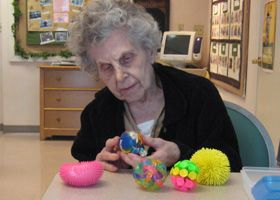 Exploring her Box of Sensory Balls - this was a good activity - we played catch, ball toss in basket.