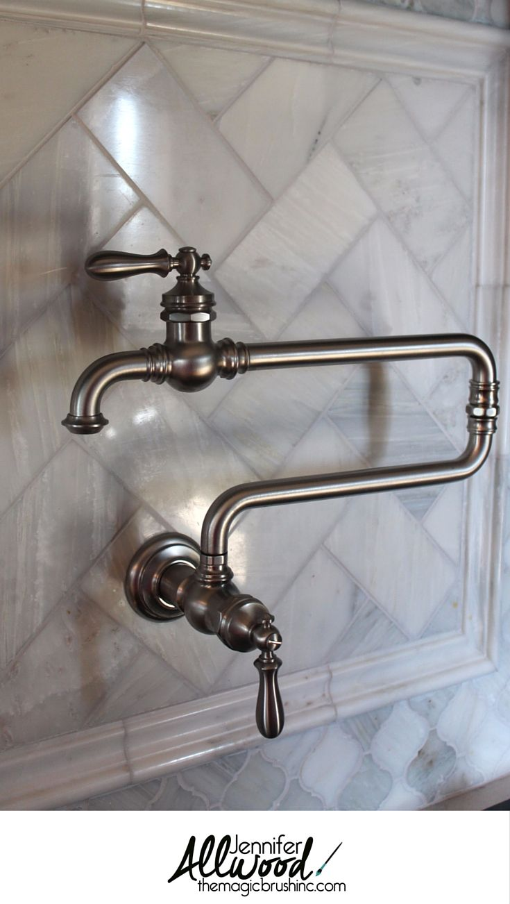 Pot Filler Faucet Idea: Here's my new gorgeous wall-mounted Kohler pot filler faucet! It completed my kitchen remodel & goes so well with my new carrera marble backsplash. More decorating tips and DIY projects at theMagicBrushinc.com