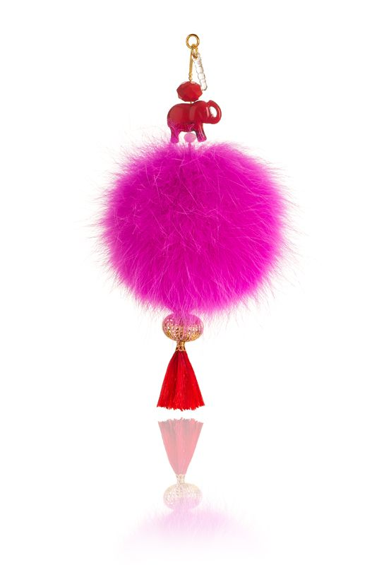 Pompon mobile Charm with 7cm fuchsia real fox fur, mobile clip, crystal beads and decorative elements. Price: 21.00E