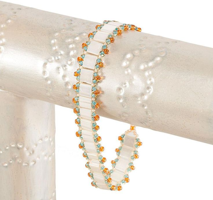 Use ladder stitch and two-hole Tila beads to stitch a single row bracelet of Tilas with bright seed bead edging perfect for layering.