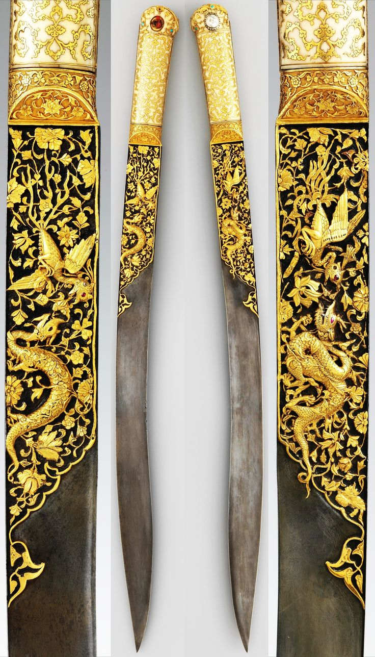 Ottoman yataghan from the Court of Suleyman the Magnificent, 16th c, workshop of Ahmed Tekelü (possibly Iranian, active Istanbul, ca. 1520–30), steel, walrus ivory, gold, silver, rubies, turquoise, pearls, gold incrustation on the blade depicts combat between a dragon and a phoenix, gold-inlaid cloud bands and foliate scrolls on the ivory grips, one of the earliest known yatagans, L. 23 3/8 in. (59.3 cm); blade L. 18 3/8 in. (46.66 cm), Met Museum.