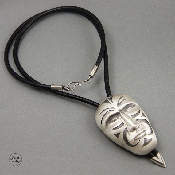 Big and original pendant - face with ornaments. Handcrafted with sterling silver. The silver is oxidated and dull. Hang on a long leather