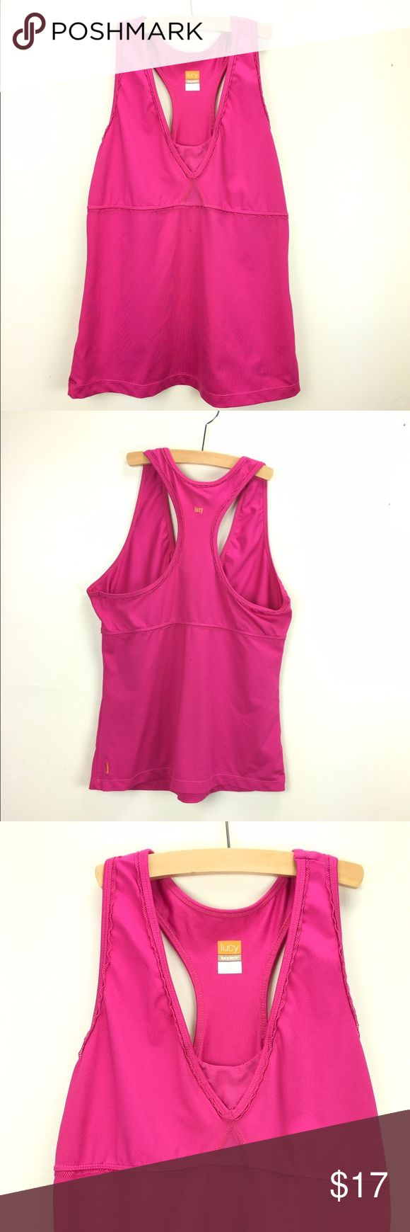 Lucy Athletic Tank Top Lucy Athletic / Sport Tank Top.  Bright pink/fuchsia. Size Medium. Ruffled trim hem. Minimal support. Definitely More of a Top than an athletic bra. Great used condition. Top shows some signs of wear as in the material is not brand new tight and a tad of fading. Still perfect to add to your sporty look. Thanks! Lucy Tops Tank Tops