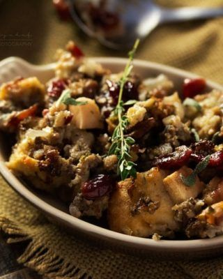 Harvest Apple Cranberry and Sage Sausage Stuffing | The ultimate sausage stuffing recipe for Thanksgiving! All your favorite Fall flavors are baked together in a perfectly textured side dish you'll love!