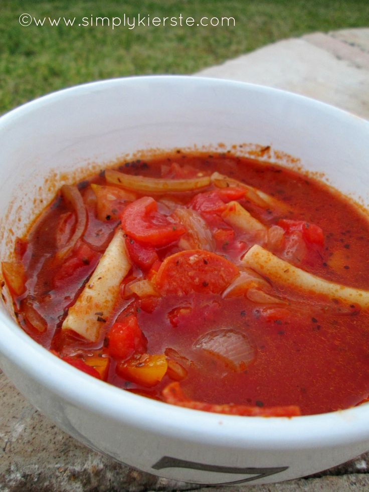 """to-die-for pizza soup - one of the YUMMIEST soup recipes you will ever make!  One of our family's favorite traditions is """"Friday Night Pizza"""", and this past Friday I substituted our regular pizza for pizza soup. Did you know, I had not one complaint?  Just an empty crockpot, second and third bowls gobbled up by EVERY child, and a request to have it again next Friday night!  THAT'S how good it is."""
