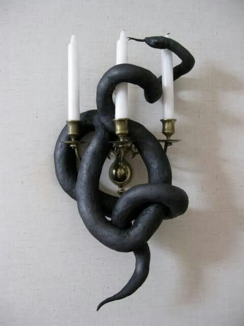 Halloween decor, Ok I hate snakes but I think this would be great outside on the porch light, scare the heck out of people