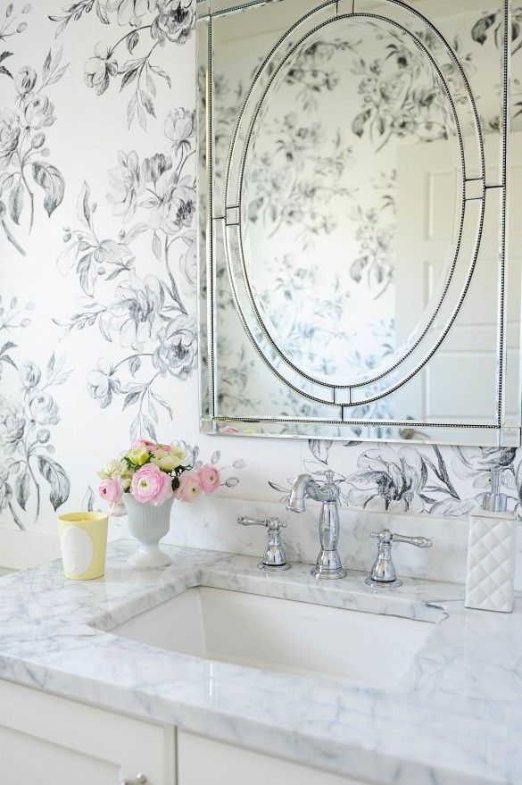Wallpaper in bathroom with flowers and rectangular mirror