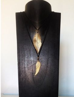 The perfect colour combination of black  & dusty gold  Pull to shorten or lengthen  Wear both together at different length for a true bohemian chic look  Made from nickel free metal & leather Size: Leaf length: 6cmWing length: 4cm