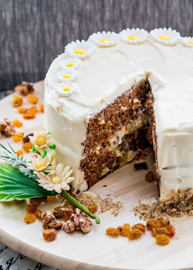 This carrot cake is perfectly moist, sweet and loaded with carrots, raisins, walnuts and pineapple, then topped with a delicious cream cheese frosting.
