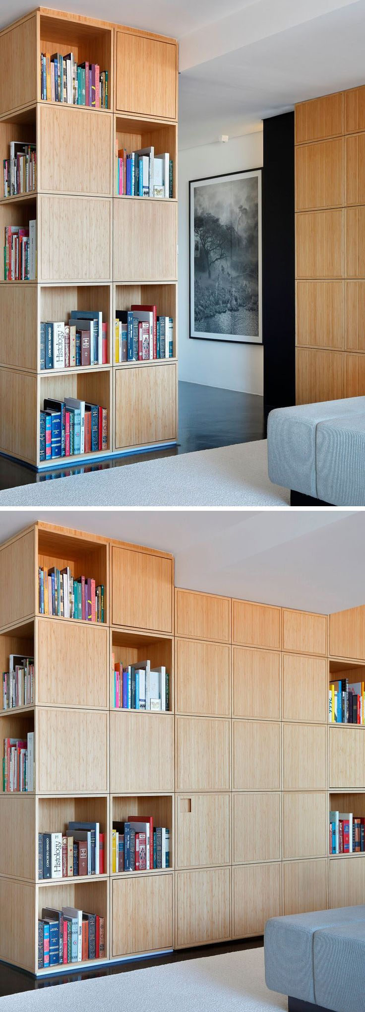 The entry hall to this modern apartment is concealed behind a u-shaped wood bookcase and is hidden from view when the door closes and blends into the rest of the bookcase.