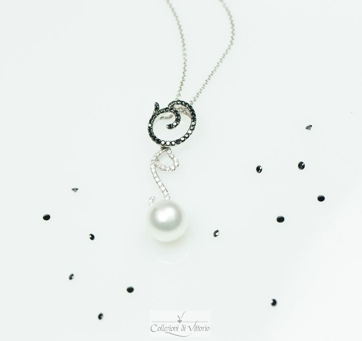 White and Black diamonds make this pearl necklace even more attractive.