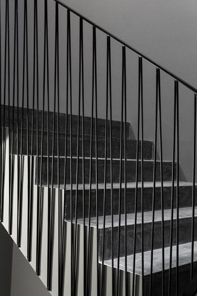 tal stair rail details. The vertical rods create 'V' forms and are aligned with the bottom of the stringer.