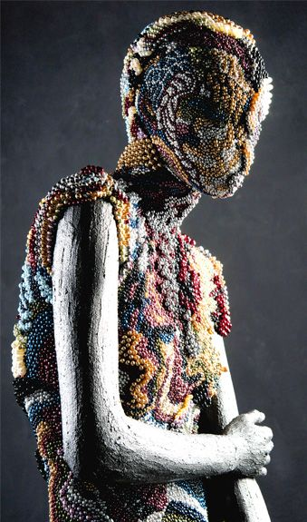 Artist and designer Johny Dar presents: 'Queen of Pearls'. The pearls all together actually form acrystallised sculpture dress that's really made with Preciosa crystal components. Thisbreathtaking expression took 15 days of intensive work to complete.This amazing work is done on a Hans Boodt Casual Abstract mannequin.