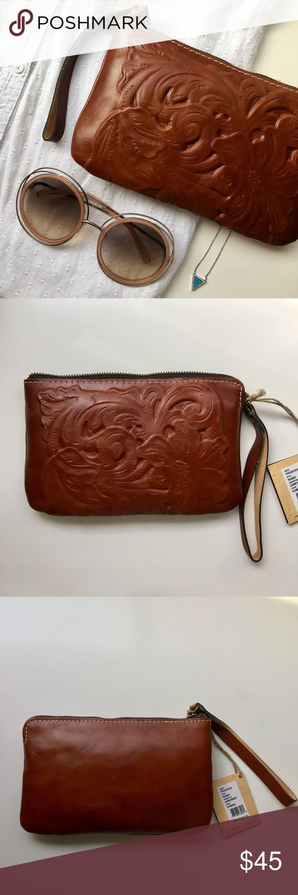 """Patricia Nash Tooled Leather Wristlet in Florence Artisanal floral embossed wristlet in a rich cognac leather. Brass tone zipper closure and leather wrist strap. Interior pockets and brand label. Dustbag included. 5""""x9"""" Fits my iPhone 6s Plus inside. Please carefully review each photo before purchase as they are the best descriptors of the item. My price is firm. No trades. First come, first served. Thank you! :) Patricia Nash Bags Clutches & Wristlets"""