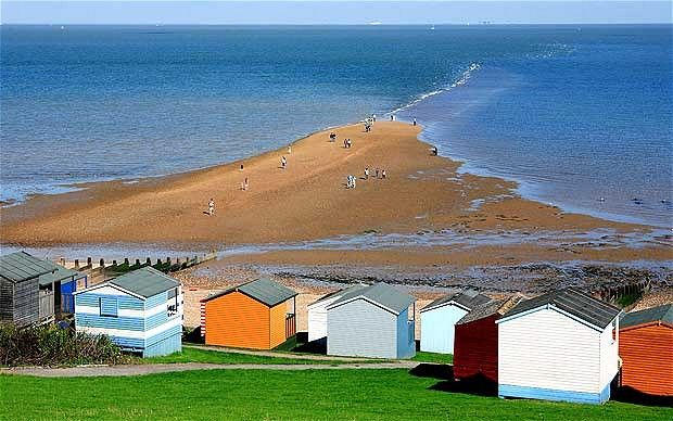 Whistable, Kent: pretty shingle beach with candy coloured huts, thriving harbour and fish market