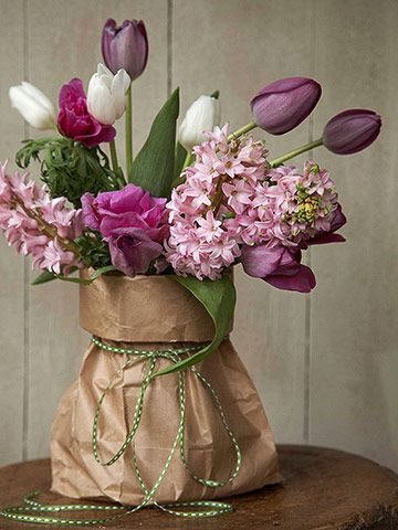 Hyacinths and tulips in shades of lilacs & lavender in a simple paper bag vase! >> So beautiful! Would make lovely table centerpieces.