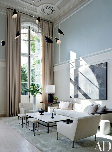 The living area. Sojourn, above the sofa, is by Tom Brydelsky. Edelman leather on armchairs. Rug, ABC Carpet   archdigest.com