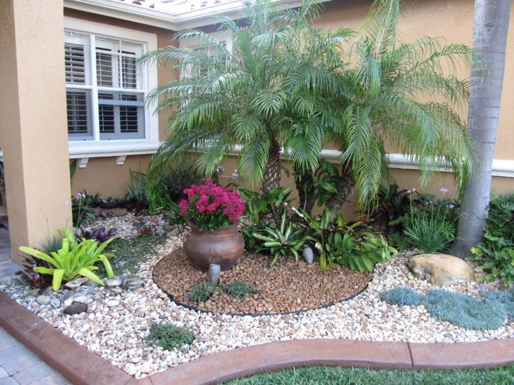 Beautify Your Home with Landscaping Ideas for Front Yard: Dwarf Trees For Landscaping In Landscaping Ideas For Front Yard Plus Decorative Gravel And Palm Tree For Tropical Landscapes In Traditional Home With Rail Chair On Exterior Wall ~ parsegallery.com Decorating Inspiration