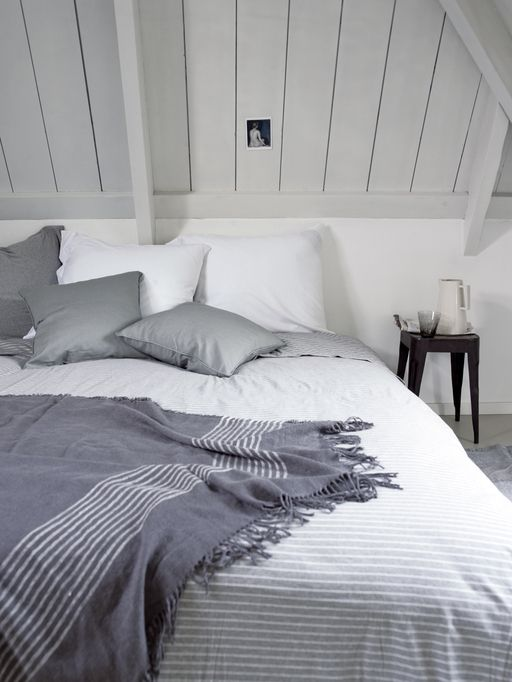 Grey and white bedroom with stripes