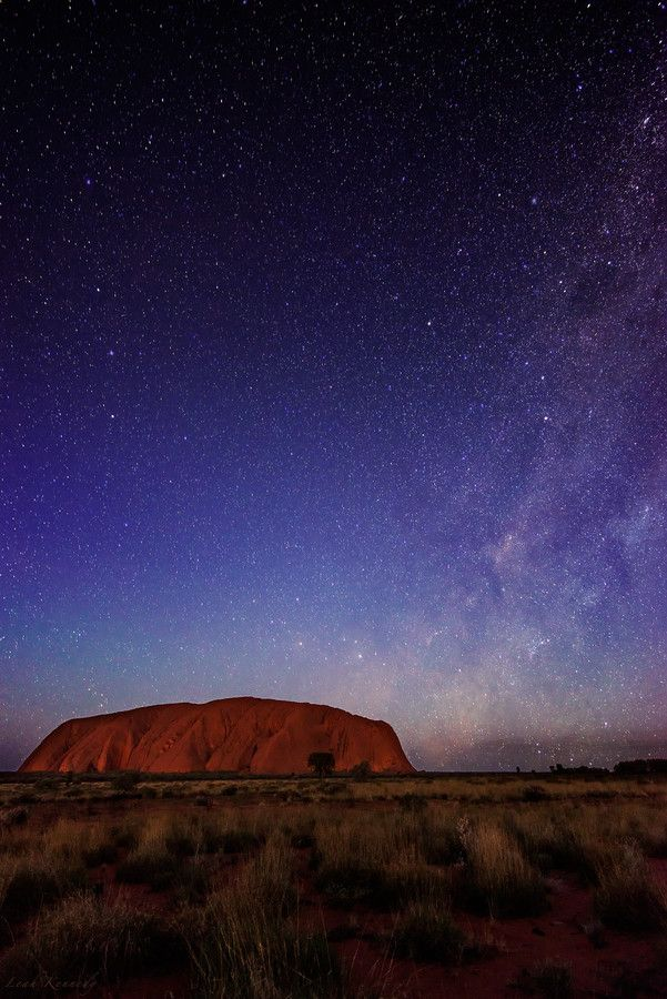 #TravelDestinations #Uluru - A starry night at Uluru (Ayers Rock) in the Northern Territory, Australia.