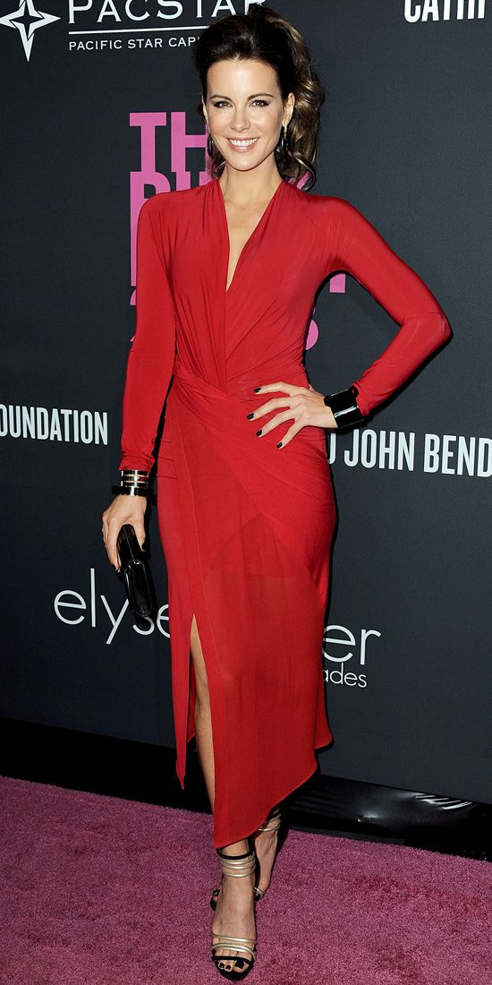 Beckinsale radiated sexiness a red-hot Donna Karan draped dress with Joan Hornig ring earrings, Pluma bracelets, a black Jimmy Choo clutch and black-and-gold Casadei heels.