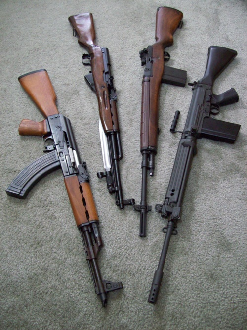 Historic military long arms of the 20th Century- (from left) AK-47, SKS, M-14/M-1A, FN FAL