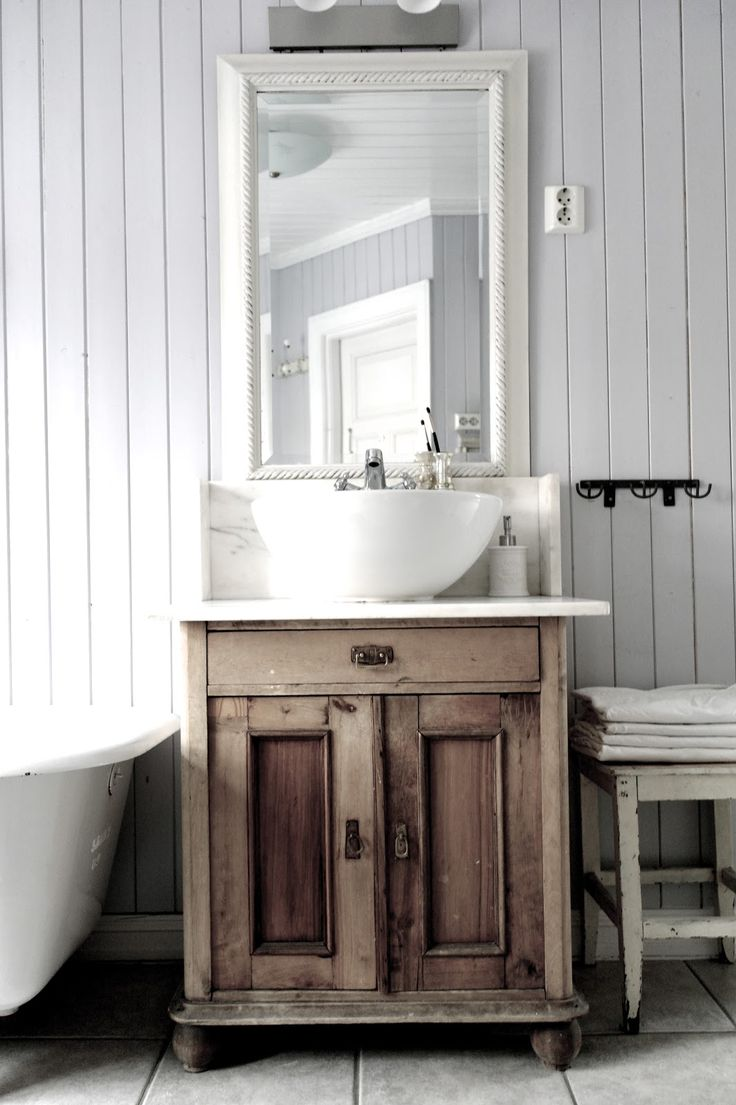 Vintage Interior  Antique stand used as bathroom vanity.