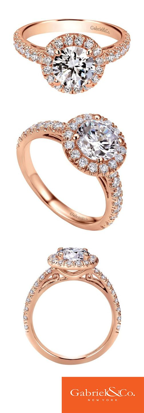 Gorgeous 14k Pink Gold Diamond Halo Engagement Ring by Gabriel & Co. We love the big center diamond surrounded by a beautiful halo. This classy ring may be simple, but it definitely stands out and makes a statement. Pick the perfect engagement ring for the love of your life with Gabriel & Co.