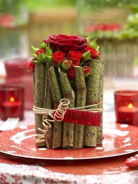 very pretty wooden sticks and roses table centerpiece